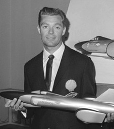 Craig Breedlove holding a model of Sprit of America