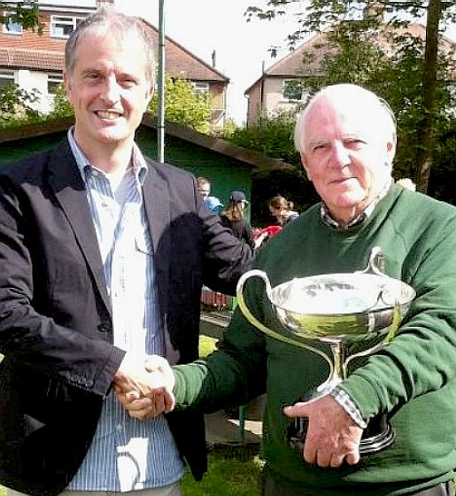 Don Wales hands the Malcolm Campbell trophy to Mike Dean