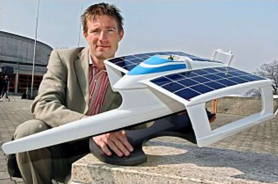 Raphael Domjan with the original PlanetSolar model trimaran