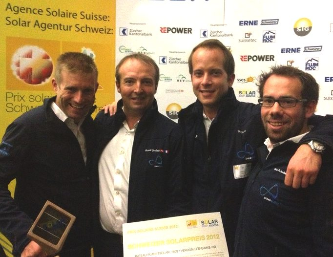 Crew of the Turanor PlanetSolar receiving a prize from Solar Agentur Scweiz