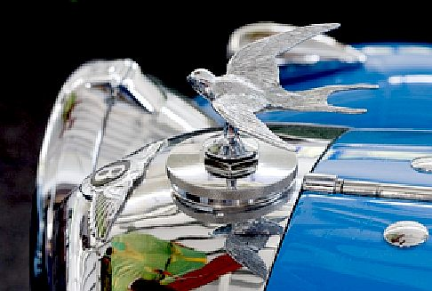 Bentley radiator filler cap with chrome plated flying bird sculpture