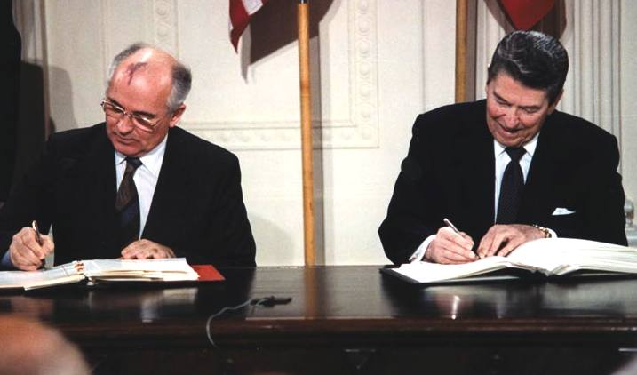 Gorbachev and Reagan signing the INF Agreement